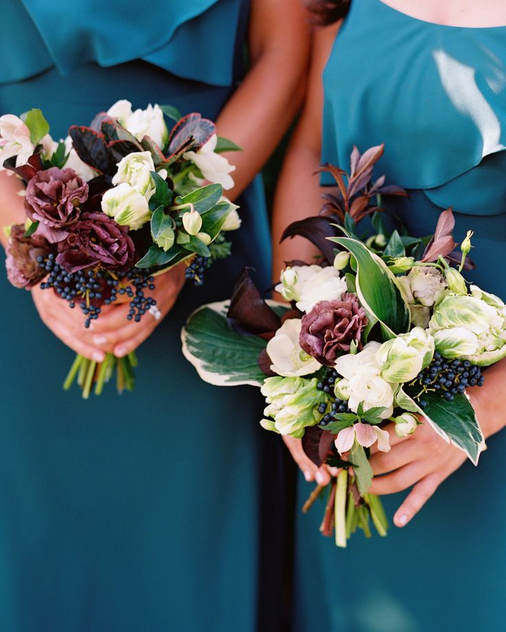 Bridesmaids carried parrot tulips, anemones, ranunculus, lisianthus, mini calla lilies, and greenery in shades of purple and white, which paired beautifully with their teal gowns.