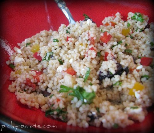 Meditteranean Couscous Salad. Made with couscous, red and yellow bell peppers, feta, olives, garlic, oliv oil, balsamic vinegar, salt, black pepper, and parsley.