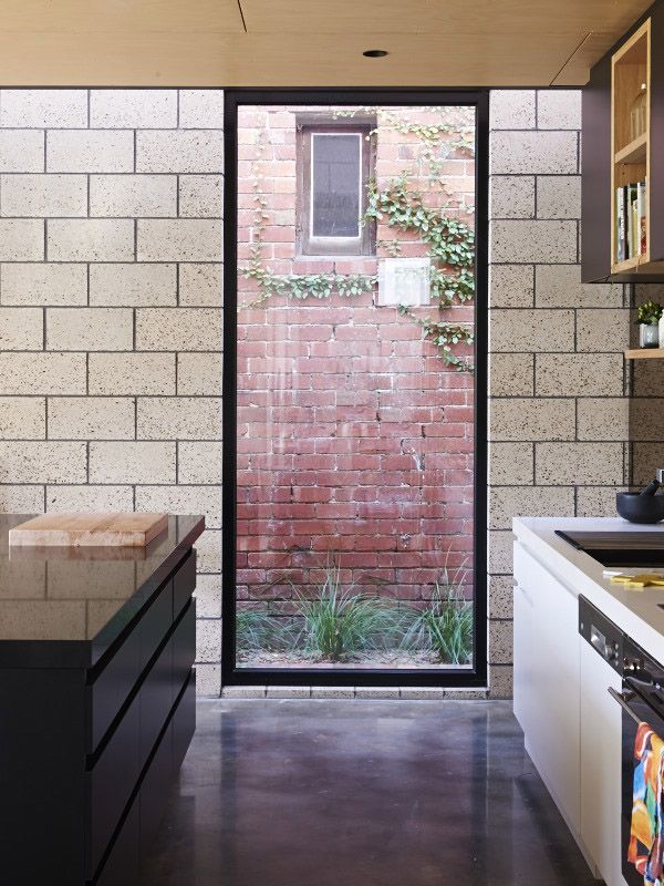Kitchen – Peekaboo window, polished concrete walls and floors, kitchen joinery by ArchiBlox. Photo - Eve Wilson. Styling Assistant - Nat Tur...