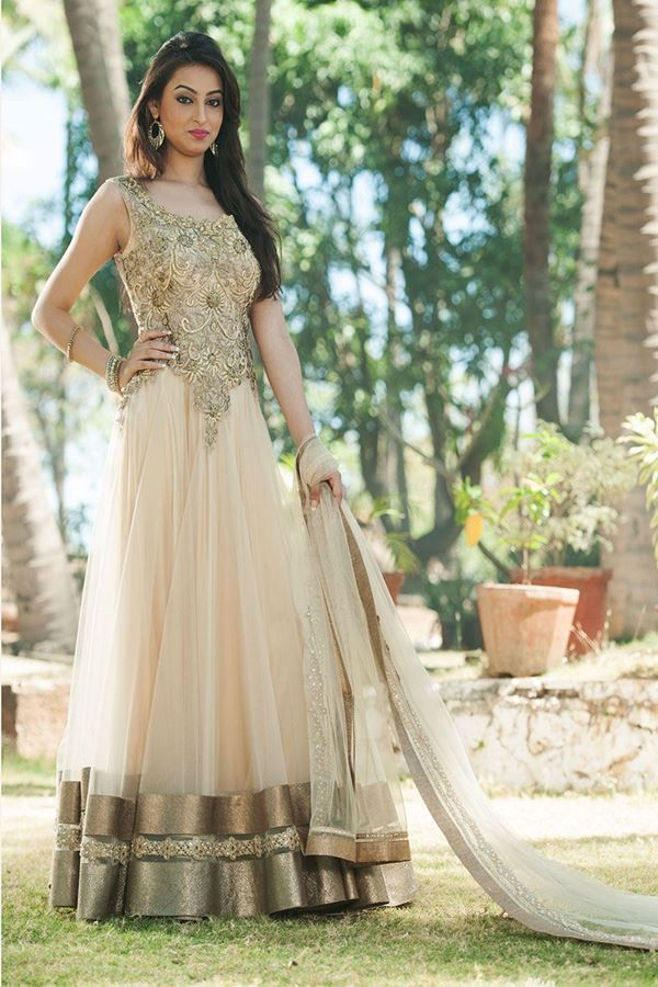 Look your ethnic best wearing this floor length beige color anarkali suit. Exquisitely designed, yoke and back portion of the anarkali kameez is engraved with thread katdana and diamonds work in floral pattern. Anarkali suit is edged with fancy borders and team golden color danglers with it which will complete your overall look whenever worn.