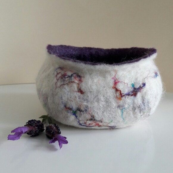 Hand felted bowl, white with delicate pattern of sari silk. Soft purple merino wool inside. This one's called Charlotte. On sale now in my Etsy shop for £20.