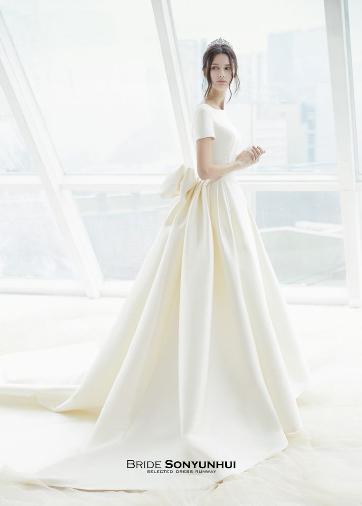 Mikado silk, A-line wedding dress. Bodice with bateau neck and short sleeves…