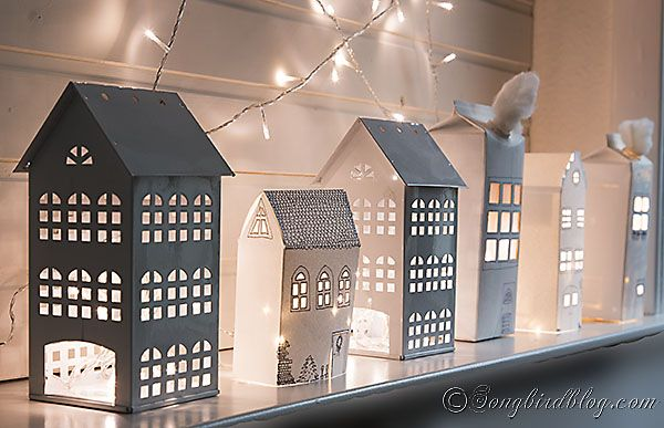 Paper houses Christmas mantel with a light star. Via http://www.songbirdblog.com