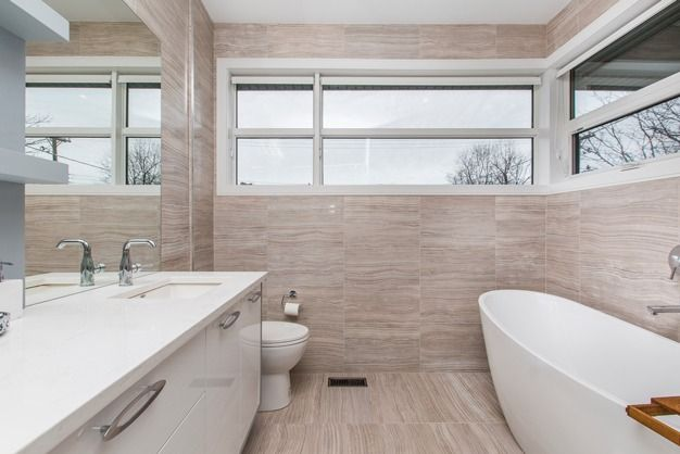 Spacious bathrooms with lots of natural light.
