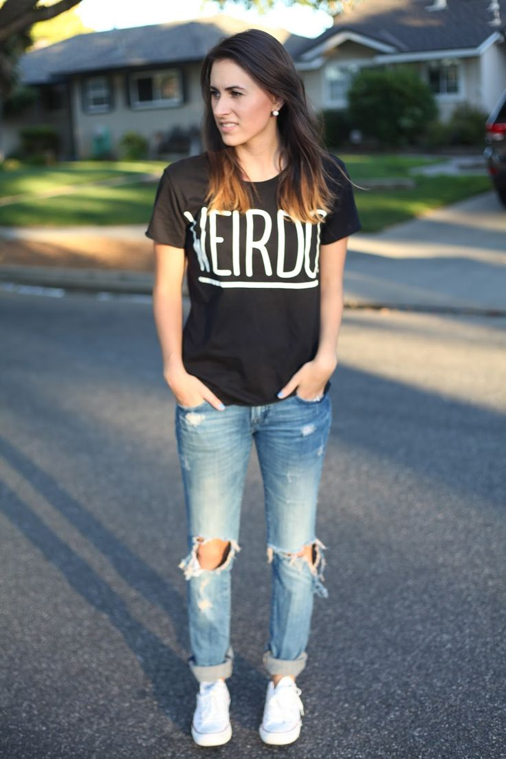 Graphic tee, ripped jeans, & sneakers.