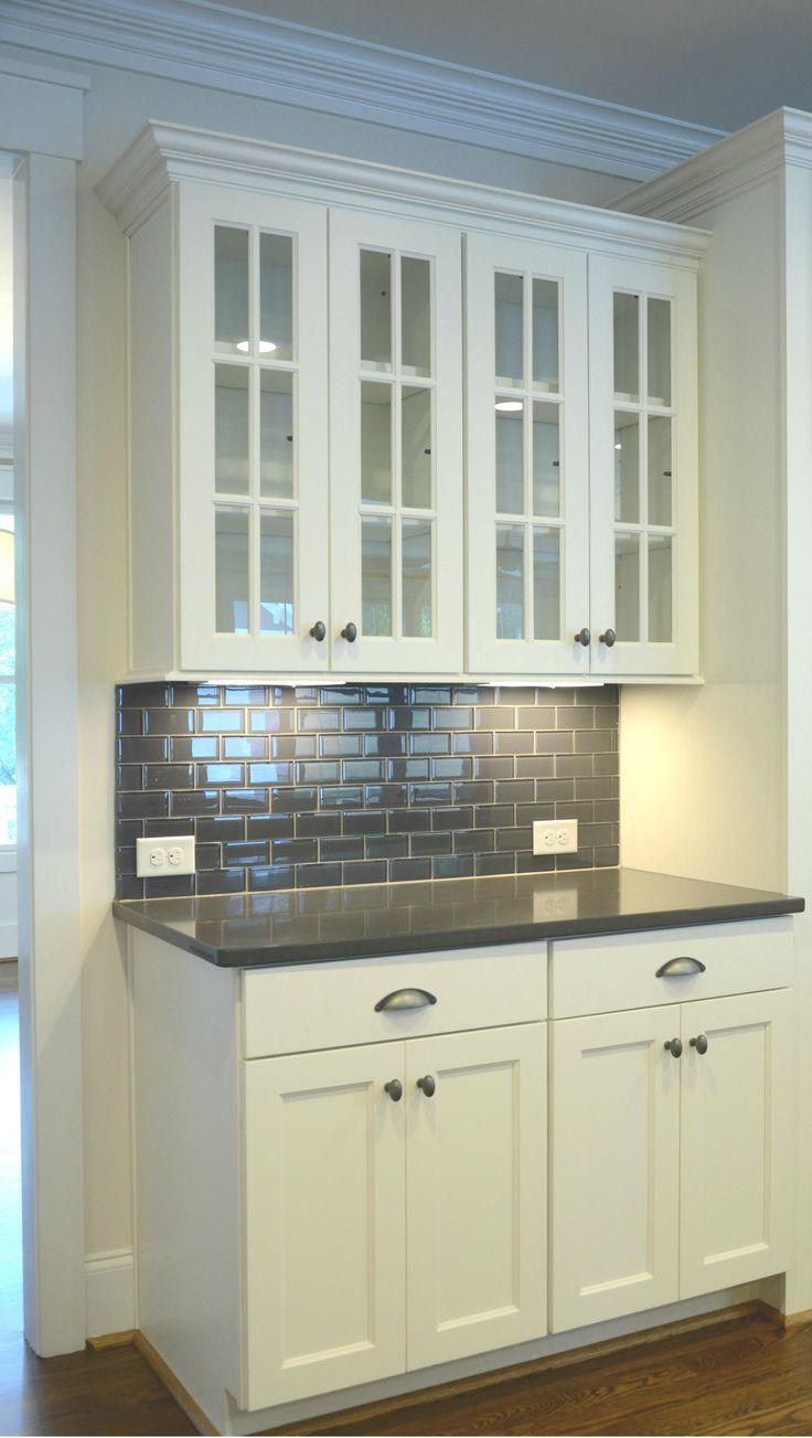 white cabinets with grey quartz countertops