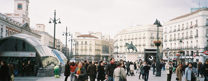 """The Plaza Puerta del Sol is one of the most iconic and representative squares of the city of Madrid. The Puerta del Sol is located in the city centre and is home to the renowned statues of """"El Oso"""", the """"Madroño"""", Carlos III and The Mariblanca.     From 1950 until 2011 was considered the 0 Km of the city, which marked the origin of the radial roads in Spain. Today, the point 0 km was relocated at the Puerta de Alcalá. Veru close from the Hotel Rex of Madrid. Hotel in Madrid city center."""