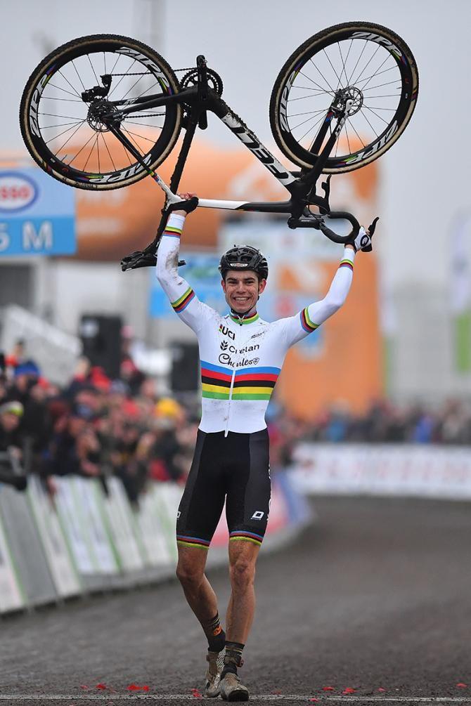 Wout Van Aert lifts his bike over his head as he clinches his 2nd Belgian cyclo-cross title (Tim de Waele/TDWSport.com)