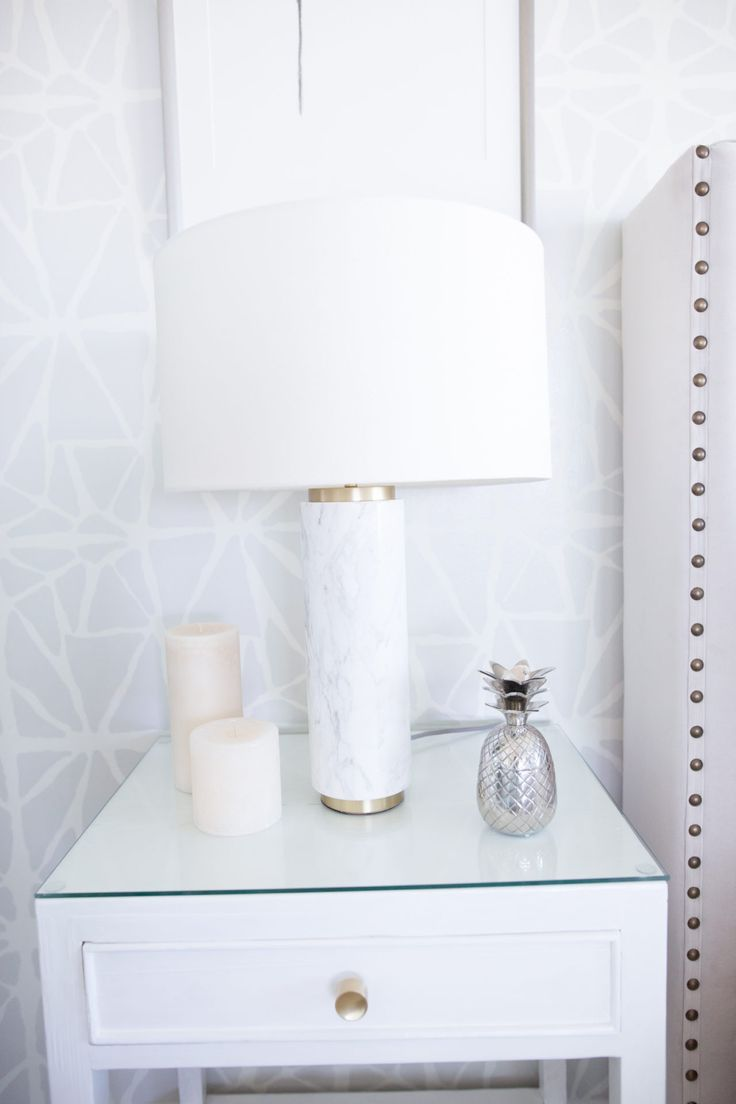 Side table goals! A white marble lamp lends such a sophisticated touch to this thrifted nightstand.