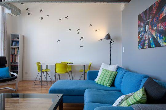 flock of birds wall art + upwards floor lamp as lighting