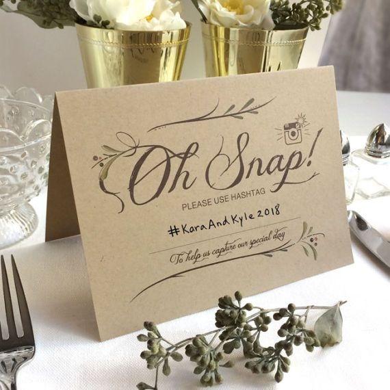 Rustic Instagram Signs - Oh Snap! Kraft Instagram Wedding Table Sign - Instagram Prop For Tables and Photo Booth - Folded Instagram Signs.  These Wedding Hashtag signs are adorable! Oh Snap! is a great way to spark a smile from all your wedding guests before they snap an awesome picture capturing your big day. Place these table signs at the bar, around your reception tables, near your photo booth, or anywhere you want to remind guests to share their pics.  Each 6 x 4 Instagram table sign is…