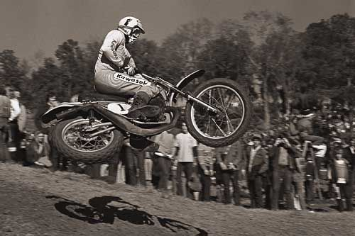 The top photo is of 1982 500cc world champion Brad Lackey on a Kawasaki during an AMA motocross race in Florida in 1973. Lackey is the only american to win the 500cc World Motocross Championship, taking the title on a Suzuki after years of trying. He also won the AMA 500cc title in 1972. Courtesy of http://www.motorsportretro.com