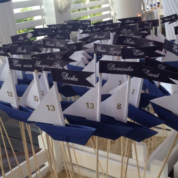 We advice you these paper boats, if you'll have a sea/lake/etc. inspired wedding. They can be table numbers or just part of the decoration. You can have it in different colour-combinations. :)
