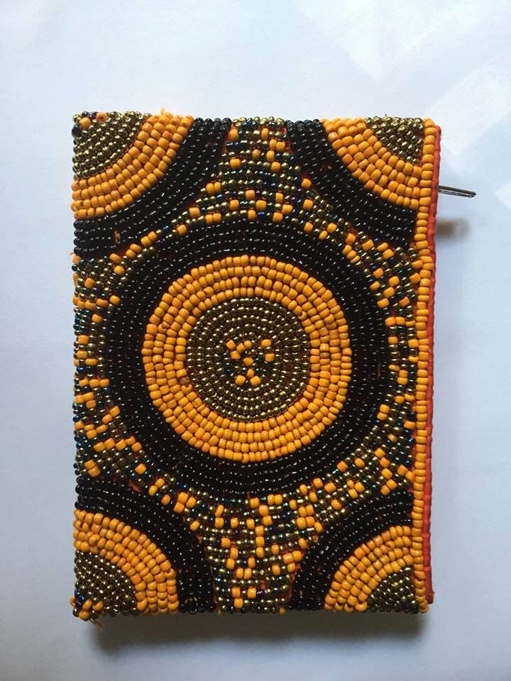 Glass Chaquira Beads Coin Purse by DahliasArtesania on Etsy https://www.etsy.com/listing/387510042/glass-chaquira-beads-coin-purse