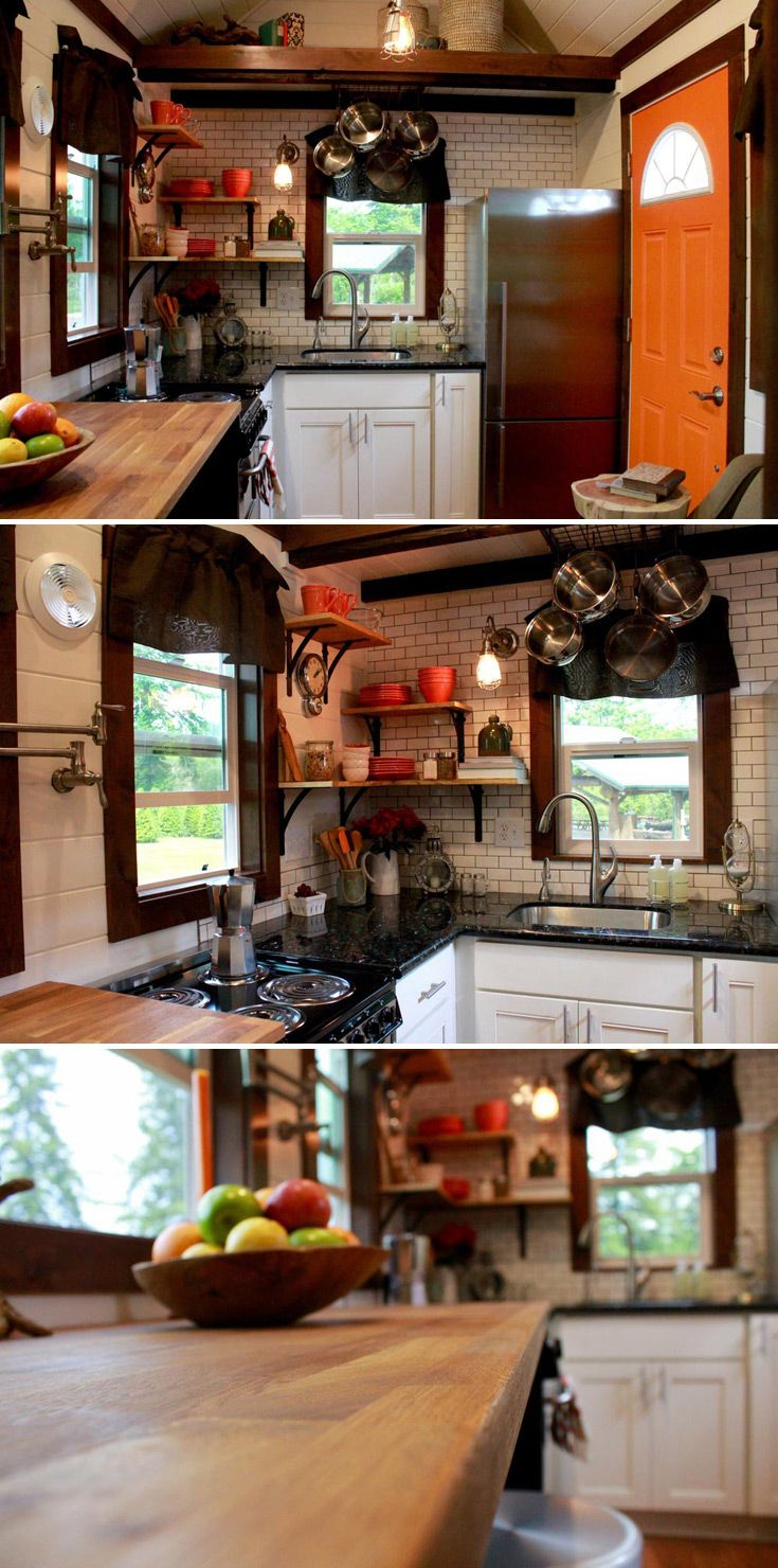 "This tiny house kitchen features a full size stainless steel refrigerator, four-burner stove, and 12' of granite and butcher block countertop space. The butcher block countertop flips open to reveal a 50"" flatscreen TV."
