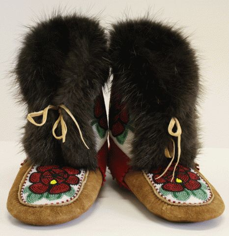 Hand Beaded Moose Hide Moccasin Mukluks with Beaver fur. Just wow. If I win the lottery, this is the first thing I'm buying.