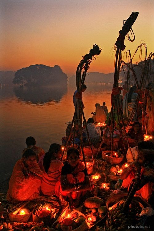 Pilgrims waiting for sunrise to offer their prayers to the sun-god Chhat Puja Kolkatta, India