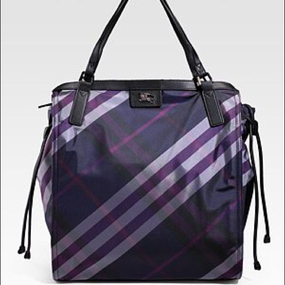 Burberry Buckleigh Packable Nylon Tote Bag Beautiful deep purple and black nylon tote from Burberry. Ideal for traveling as you can pack it away. Second image is not the bag color, but shows the leather features. Gunmetal silver embellishments and logo, black leather straps and cinch ties at sides. Zipper on top, zippered pocket inside. Lightweight and extremely durable! Burberry Bags Totes