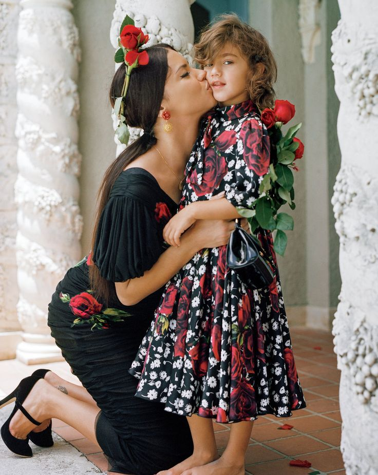 Domenico Dolce & Stefano Gabbana - Adriana Lima with her daughter Valentina. Lima wears a Dolce & Gabbana silk dress, purse, and shoes. Valentina wears a Dolce & Gabbana Children's floral dress.  Hair: Recine; Makeup: Aaron de Mey; Fashion Editor: Tabitha Simmons