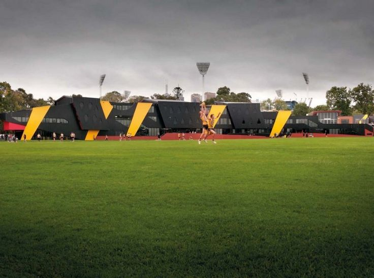 Richmond Football Club Punt Road Oval Redevelopment / Suters Architects - The Richmond Football Club, Punt Road Oval redevelopment for Richmond Football Club is an elite, multipurpose sports facility that combines high performance training, treatment and recovery, education, workplace and retail components. Suters Architects were asked to develop a concept that balances the requirements of an elite level training facility...