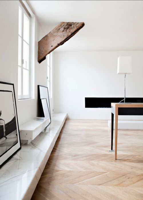 Not sure I love the space, but I love the juxtapostion of the rough hewn wood with the clean marble and crafted wood floor . . .