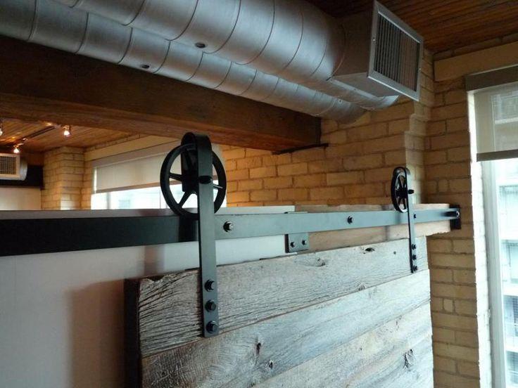 REBARN's very own custom 6 inch spoke wheels powder coated black barn door hardware. Worth the extreme close up!