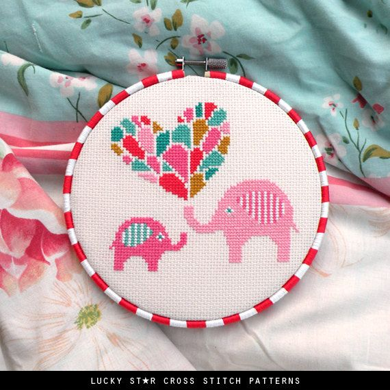Cute little elephants and a love heart feature in this simple cross stitch design. A parent giving love to its baby – perfect for nursery