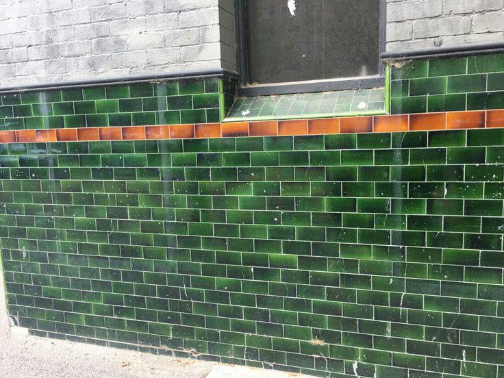 PHOTO 1: This green tile wall is very bright and shiny, and therefore creates a very eye catching look, especially as it is placed in public, it definitely gives a effective look to the viewers.
