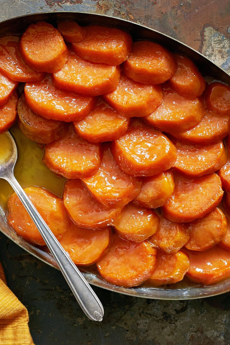 "It was in ""The Harvey House Cookbook"" that we found this excellent recipe for sweet potatoes candied with confectioners' sugar and butter. It is best served warm rather than piping hot, which makes it convenient for big meals like Thanksgiving. Bake it before you roast your turkey, then reheat it briefly just before serving. (Photo: Melina Hammer for NYT)"