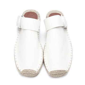 Stylishly versatile and easy to slip on in a flash, these slide shoes hug  your foot with leather look upper and woven sole, while the pin buckle  embellishes ...