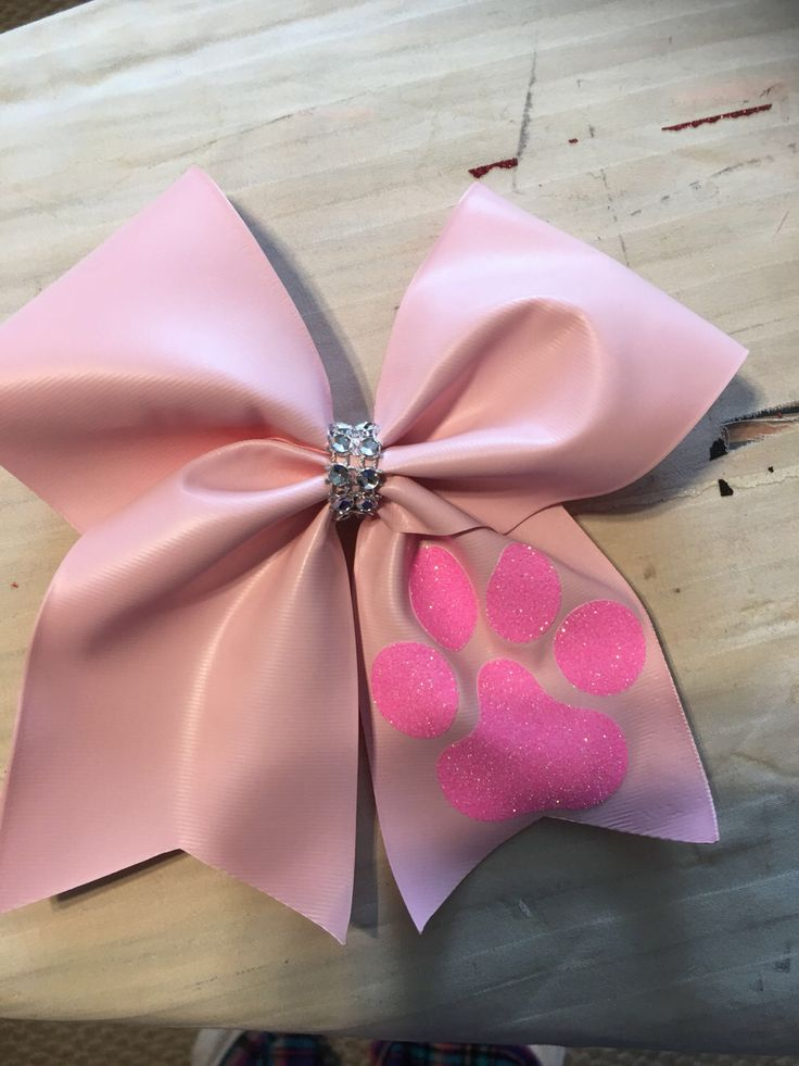 Paw Print Pink Cheer Bow by RouzandLezar on Etsy https://www.etsy.com/listing/506991696/paw-print-pink-cheer-bow