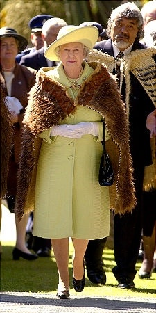 Queen Elizabeth II sports a cloak made of New Zealand bird feathers over her coat. She arrives at the meeting house of the Ngai Tahu, a Maori tribe of the southern islands of New Zealand in 2002.