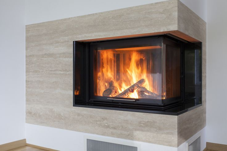 Travertine fireplace open on two sides