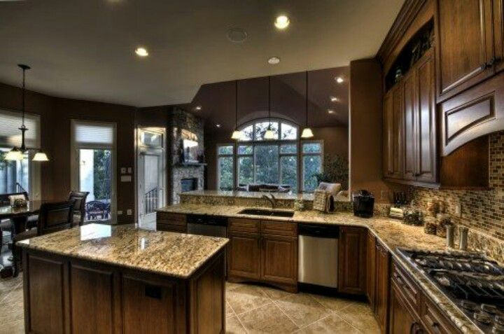 Beautiful coordination of granite and tile kitchen for Beautiful traditional kitchens