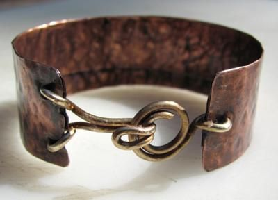Love the clasp.  Rustic Copper Cuffs by Zoraida - interesting