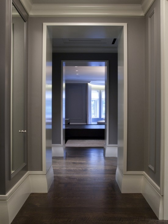 Dark grey works so well with the white high gloss woodwork.  I love the walnut floor as well.