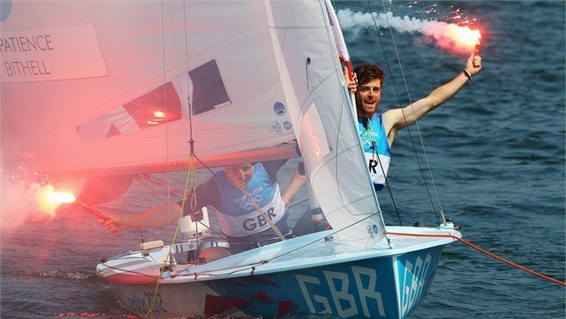 Luke Patience (R) and Stuart Bithell (L) of Great Britain let off flares as they celebrate finishing second and winning the silver medal in the Men's 470 Sailing on Day 14 of the London 2012 Olympic Games at the Weymouth & Portland venue