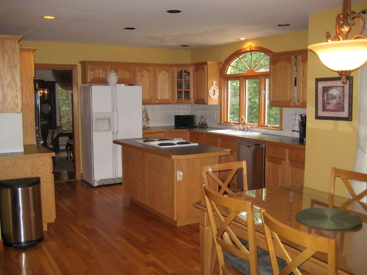 yellow walls, warm wood cupboards, white fridge, stainless, and green ~!~