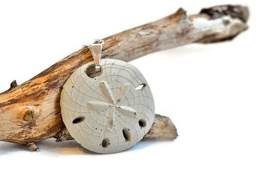 A beautiful beach inspired,  sand dollar necklace made of concrete