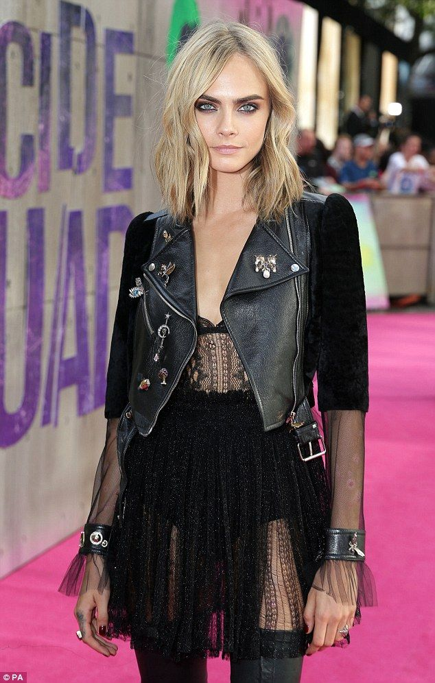 Cara Delevingne rocks out in a VERY racy sheer dress