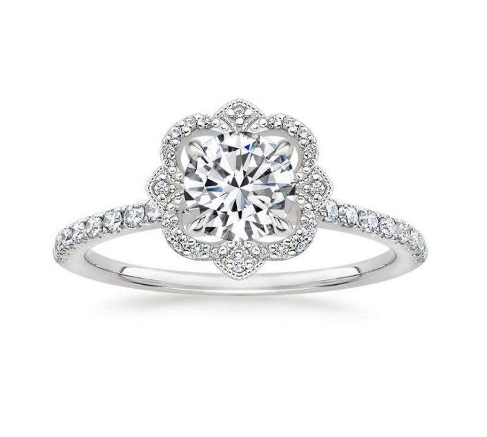 ''Bolena'' Crown Halo Engagement Ring with Diamond Side Stones A regal halo of diamond accents surrounds a shimmering center diamond in this dazzling ring for a distinctive and elegant look. Mounting type: Contemporary Halo Band Width: 1.7 mm Extra Small Diamonds: 38-40
