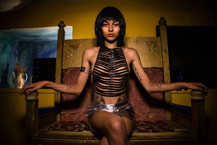 Latex body chain, Iron bracelet with spikes,   silver skirt. Photo by Tina Dubrovsky