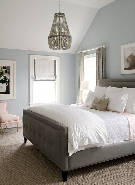 Light grey walls, white bedding, light hardwood floors with our dark wood woodwork & cabinetry.
