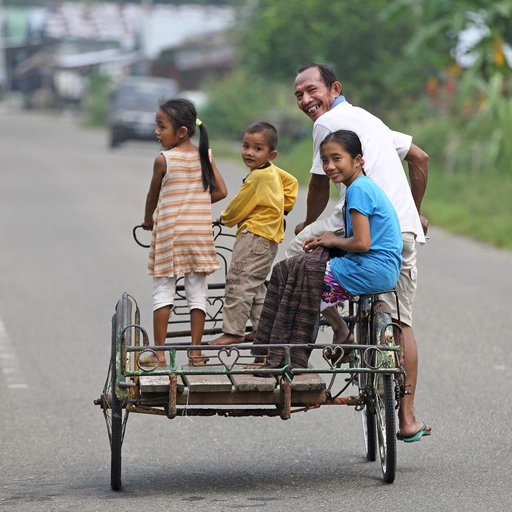 Family on a cykel Becak in Gunungsitoli, the main town on Nias Island. North Sumatra, Indonesia. Photo by Bjorn Svensson. www.visitniasisland.com