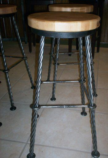 """welding project - stool NOTE TO SELF: 3 pieces of 3/8"""" round rod. weld two ends together, put in vise, heat and twist. Cut to length afterwards."""
