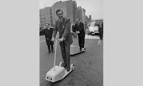Forward into yesterday's tomorrow ... US senators Edmund Muskie and Warren G Magnuson demonstrate electric-powered scooters. Photograph: Wal...