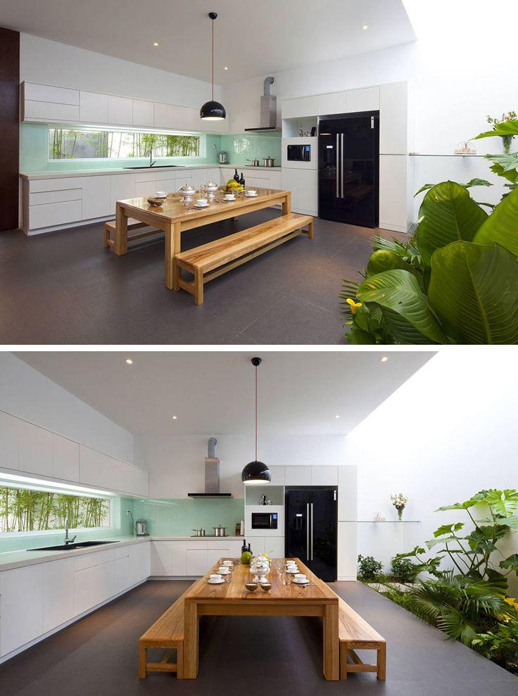 Kitchen Design Ideas - 9 Backsplash Ideas For A White Kitchen / Add a pop of color with a colored glass backsplash.