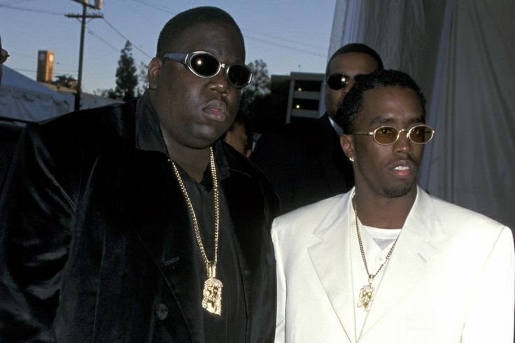 Biggie & Puffy Jerseys, baggy jeans, and sneakers took somewhat of a backseat around 1995, when Death Row and Bad Boy Records were at the height of their success. Instead, rappers started to develop a taste for designer clothes and accessories, and mainstream hip hop as a whole adopted a decidedly more glamorous image.
