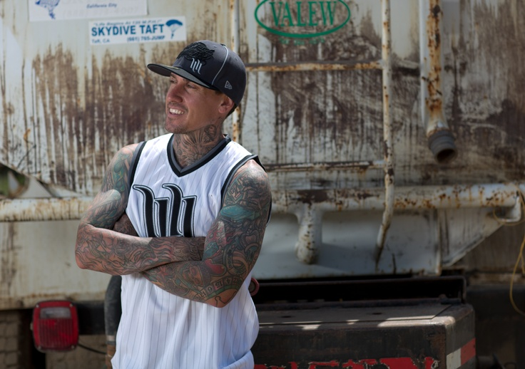 The myth, the man, the legend, Carey Hart showing off his tats