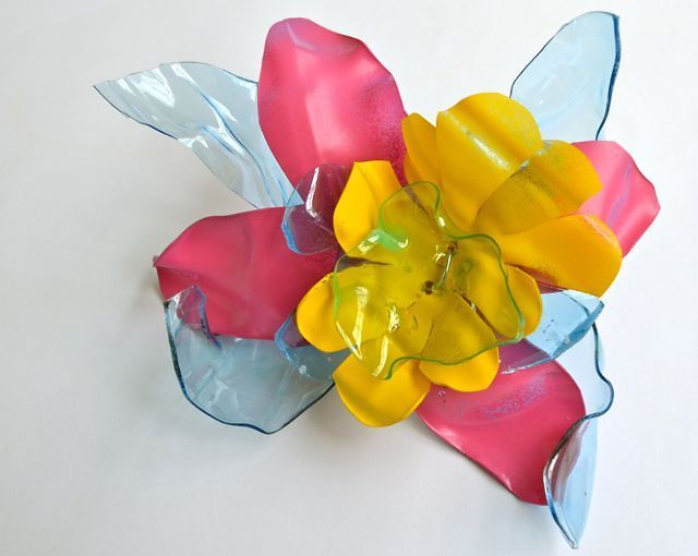 Recycled Plastic Bottle Flower by EVE Estuary. How to create a plastic flower out of an old plastic bottle.